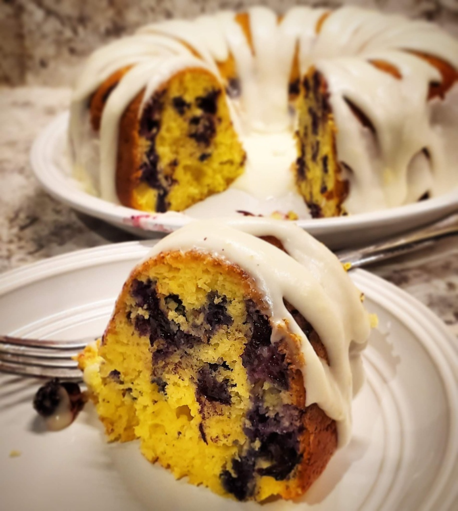 Finished lemon blueberry Bundt cake with lemon glaze.
